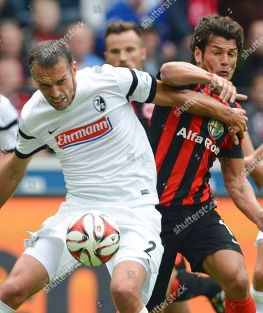 Frankfurt's Nelson Valdez (r) and Freiburg's Pavel Krmas During the German Bundesliga Match Between Eintracht Frankfurt and Scáfreiburg at Commerzbank Arena in Frankfurt Main Germany 23 August 2014 (attention: Due to the Accreditation Guidelines the Dfl Only Permits the Publication and Utilisation of Up to 15 Pictures Per Match on the Internet and in Online Media During the Match ) Germany Frankfurt Main
