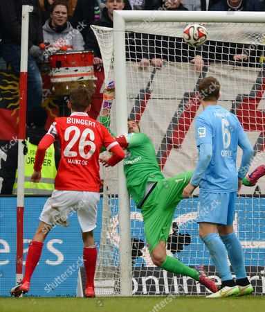 Mainz's Niko Bungert (l) and Frankfurt's Bastian Oczipka (r) Watch the Ball Fly Past Frankfurt's Goalkeeper Kevin Trapp During the German Bundesliga Soccer Match Between 1st Fsvámainz 05 and Eintracht Frankfurt at the Coface Arena in Frankfurt/main Germany 21 February 2015 (embargoáconditions - Attention - Due to the Accreditation Guidelines the Dfláonly Permits the Publication and Utilisation of Up to 15 Pictures Per Match on the Internet and in Online Media During the Match) Germany Mainz