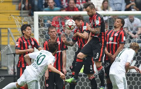Frankfurt's Players Makoto Hasebe (l-r) Alexander Madlung Marco Russ Haris Seferovic and Timothy Chandler with Leverkusen's Stefan Kiessling in Action After a Free Kick From Leverkusen's Hakan Calhanoglu During German Budesliga Soccer Match Between Eintracht Frankfurt and Bayer Leverkusen in the Commerzbank Arena Frankfurt Germany 23 May 2015 Germany Frankfurt