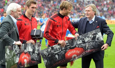 Bayer Leverkusen's Simon Rolfes (2nd R) and Stefan Reinartz (2nd L) Are Farewelled by Rudi Voeller (l) and Club Manager Michael Schade in the German Bundsliga Match Between Bayer Leverkausen and 1899 Hoffenheim at the Bayarena in Leverkusen Germany 16 May 2015 (embargo Conditions - Attention - Due to the Accreditation Guidelines the Dfl Only Permits the Publication and Utilisation of Up to 15 Pictures Per Match on the Internet and in Online Media During the Match) Germany Leverkusen