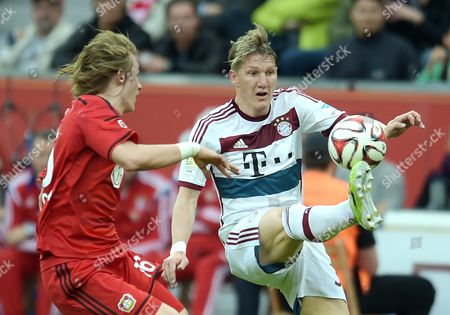 Leverkusen's Tin Jedvaj (l) and Bayern's Sebastian Schweinsteiger Vie For the Ball at the German Bundesliga Soccer Match Between Bayer Leverkusen and Bayern Munich in the Bayarena in Leverkusen Germany 02 May 2015 (embargoáconditions - Attention - Due to the Accreditation Guidelines the Dfláonly Permits the Publication and Utilisation of Up to 15 Pictures Per Match on the Internet and in Online Media During the Match) Germany Leverkusen