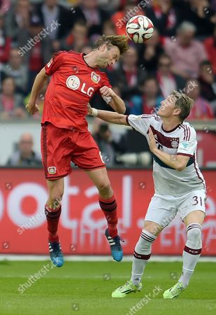 Leverkusen's Simon Rolfes (l) and Bayern's Sebastian Schweinsteiger Vie For the Ball at the German Bundesliga Soccer Match Between Bayer Leverkusen and Bayern Munich in the Bayarena in Leverkusen Germany 02 May 2015 (embargoáconditions - Attention - Due to the Accreditation Guidelines the Dfláonly Permits the Publication and Utilisation of Up to 15 Pictures Per Match on the Internet and in Online Media During the Match) Germany Leverkusen