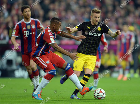 Stock Picture of Munich's J?rome Boateng and Dortmund's Marco Reus (r) Vie For the Ball During the German Bundesliga Soccer Match Between Fc Bayern Munich and Borussia Dortmund at Allianz Arena in Munich Germany 01 November 2014 (attention: Due to the Accreditation Guidelines the Dfl Only Permits the Publication and Utilisation of Up to 15 Pictures Per Match on the Internet and in Online Media During the Match ) Germany Munich