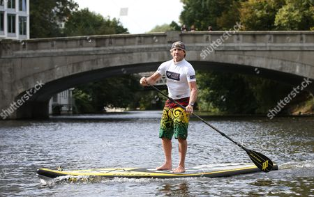 Usásurfing Legend Robby Naish Crosses a Stretch of Water on His 'Stand Up Paddle Board' in Hamburg Germany 25 September 2014 Naish is in Hamburg to Promote the Windsurf World Cup at Brandenburg Beach in Westerland on the Island of Sylt From 26 September to 05 October 2014 Germany Hamburg
