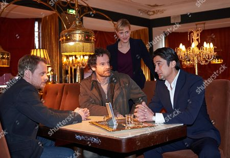 From (l-r) Actors Stefan Konarske As Inspector Daniel Kossik Joerg Hartmann As Chief Inspector Peter Faber Anna Schudt As Chief Inspector Martina Boenisch and Adrian Can As Drug Dealer Tarim Abakay Pose During a Photocall For the Shooting of the Episode 'Kollaps' of the German Tv Series 'Tatort' in the Cafe 'Oma Doris' in Dortmund Germany 02 March 2015 the Episode is Situated in the Drug Milieu Germany Dortmund
