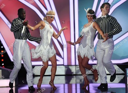Stock Photo of A Picture Made Available on 16 May 2015 of Former Soccer Player Hans Sarpei (l) with Austrian Dancer Karthin Menzinger (2-l) and German Former Weightlifter Matthias Steiner (r) with Russian Dancer Ekaterina Leonova (2-r) Performing During the Rtl Television Program 'Let's Dance' German Version of 'Dancing with the Stars' in Cologne Germany 15 May 2015 Germany Cologne