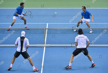 Stock Photo of Julien Benneteau and Nicolas Mahut (top L) of France and Andre Begemann (front R) and Benjamin Becker of Germany in Action During the Doubles of the Tennis Davis Cup at Fraport Arena in Frankfurt/main Germany 07 March 2015 Germany Frankfurt/main