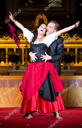 German Actor Georg Preusse (r) As Jedermann and Actress Barbara Wussow (l) As Buhlschaft Perform During the Press Rehearsal For the 28th Berlin Jedermann Festival in the Berlin Cathedral Berlin ágermany 14 October 2014 the Festival Runs From 16 to 26 October á Germany Berlin