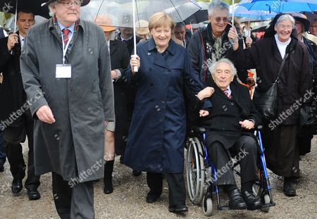 German Chancellor Angela Merkel (c) and Holocaust Survivor Max Mannheimer (r) Attend the Commemoration Event Marking the 70th Anniversary of the Liberation of Dachau Concentration Camp by Allied Forces at the Former Camp in Dachau Germany 03 May 2015 More Than 200 000 People From Across Europe Were Interned Under Dire Conditions at Dachau the First Nazi Concentration Camp Established and Its Numerous Sub-camps Between 1933 and 1945 Germany Dachau