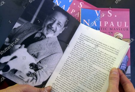 Frankfurt Am Main Germany : a Visitor of the Frankfurt Book Fair Looks at a Book by Trinidad-born British Author V S Naipaul Thursday 11 October 2001 Naipaul Won the Nobel Literature Prize on Thursday For Works That Compel Us to See the Presence of Suppressed Histories  the Swedish Academy Said