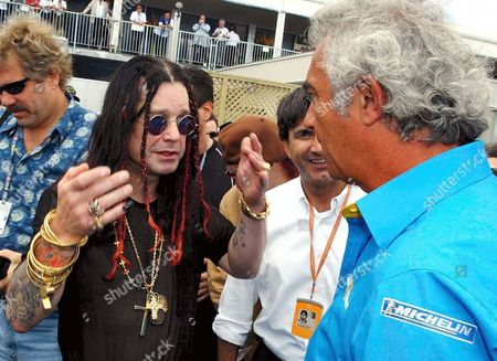 Us Rock Star Ozzy Osborne (l) Talks to Head of the Renault Team Flavio Briatore (r) at Gilles-villeneuve Circuit in Montreal Ahead of the Canadian Formula One Grand Prix 15 June 2003 German F1 Driver Ralf Schumacher of Bmw-williams Took the Pole Position Ahead of Teammate Juan Pablo Montoya of Colombia and Borther Michael Schumacher of Ferrari Epa-photo/dpa/boris Roessler Canada Montreal