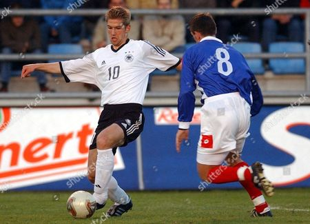 Wilhelmshaven Germany : Thomas Hitzelsperger (l) of Germany and Dejan Milovanovic (r) of Serbia-montenegro Tussle Fo the Ball During Their U21 Soccer Match in Wilhelmshaven Northern Germany on Tuesday 29 April 2003