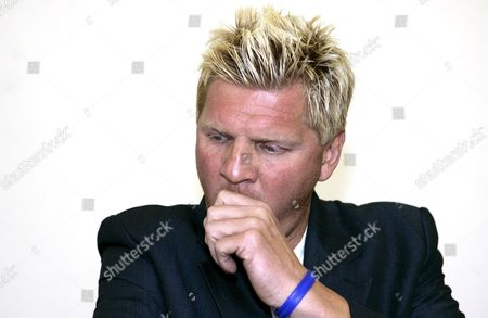 Former German Soccer Star Stefan Effenberg Covers His Mouth with His Hand in Courtbrauschweig Germany Wednesday 13 April 2005 the District Court in Braunschweig Wants to Clear Again in a Court of Appeal if Effenberg Called a Police Officer 'Asshole' in 2003 in 2003 District Court Fined the Former Professional Soccer Player with 100 000 Euros For Verbal Offence Effenberg Tries to Exhaust All Possible Remedies Germany Braunschweig