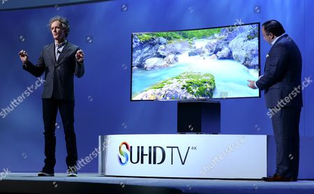 Stock Image of The Designer Yves Behar (l) and Executive Vice President of Samsung Electronics America Joe Stinziano (r) Present a Samsung Curved Tv Equipped with Display Technology Suhd Tv During a Press Conference at the 2015 International Consumer Electronics Show (ces) in Las Vegas Nevada Usa 05 January 2015 Ces the World's Largest Annual Consumer Technology Trade Show Runs From 06 to 09 January 2015 and is Expected to Feature 3 500 Exhibitors Showing Off Their Latest Products and Services to About 150 000 Attendees United States Las Vegas