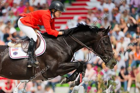 Rider Beezie Madden of Usa on Horse Cortes C Clears an Obstacle During the Speed Jumping Competition at the World Equestrian Games 2014 in Caen France 06 September 2014 France Caen