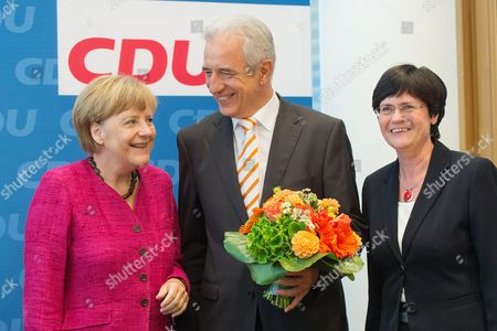German Chancellor Angela Merkel (l) Presents Flowers to Federal State Saxony's Prime Minister Stanislaw Tillich (c) with Federal State Thuringia's Prime Minister Christine Lieberknecht Ahead of a Christian Democrats (cdu) Board Meeting on the Saxony Regional Elections Results in Berlin Germany 01 September 2014 Chancellor Merkel's Christian Democrats (cdu) Won the Regional Elections in the Eastern German State of Saxony with 39 4 Percent of the the Votes While the Cdu Remained the Leading Force in Saxony's Assembly Support For the Party Slumped to Its Lowest Level Since Germany's Unification 24 Years Ago Epa/maurizio Gambarini Germany Berlin
