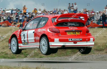 The Car of Britain's Richard Burns and Robert Raid is Airborne During the Adac Rallye Germany in Baumholder on Saturday 26 July 2003 the Pilots Will Have to Go Through 22 Tests Which Count For the World Championships Until Sunday when the Race Ends in Trier Epa Photo/dpa/harald Tittel Germany Baumholder