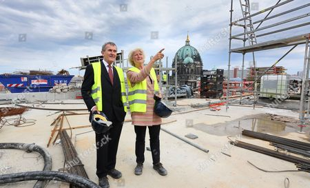 British Art Historian Neil Macgregor (l) the Founding Artistic Director of the Humboldt Forum and German State Minister of Culture Monika Gruetters Chat at the Palace Construction Site During a Tour in Berlin Germany 05 May 2015 Germany Berlin