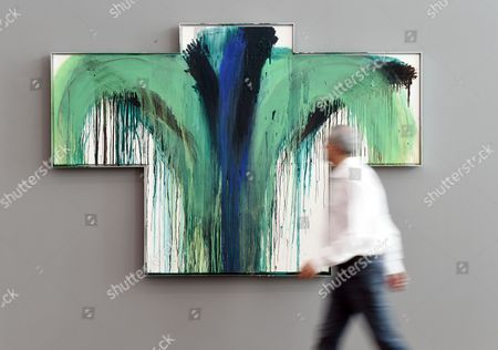 Stock Picture of A Visitor Walks by the Work 'Platanenkreuz' From 1990/91 by Austrian Artist Arnulf Rainer at the Museum Frieder Burda in Baden-baden Germany 25 February 2015 the Retrospective 'Arnulf Rainer' Opens to the Public From 28 February to 03 May Germany Baden-baden