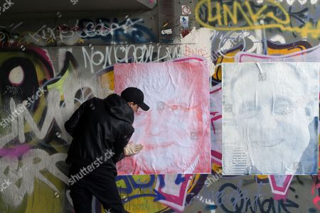 Italian Media Artist Paolo Cirio Glues Portraits of Former Cia Director Michael Hayden (l) and Nsa Director Michael S Rogers Onto a Wall Under the Elsenbruecke Bridge in Berlin Germany 19 May 2015 Cirio Opens His Exhibition 'Overexposed' with Abstracted Pictures of Senior Intelligence Officials at the Galerie Nome on 22 May Germany Berlin