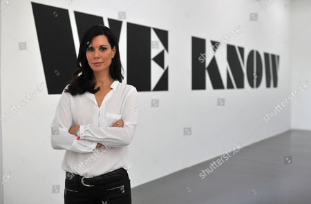 German Art Collector Julia Stoschek Poses in Front of the Lettering 'We Know' During a Preview of the Exhibition 'Number Nine: Elizabeth Price' at the Julia Stoschek Collection in Duesseldorf Germany 02 September 2014 the Exhibit Presents Works by Birtish Video Artist Elizabeth Price From 06 September 2014 to 01 February 2015 Germany Duesseldorf