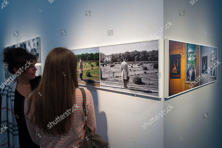 Women Look at Works of Photographer Meyerowitz at the Exhibition 'Joel Meyerowitz Retrospective' at Nrw-forum in Duesseldorf Germany 25 September 2014 the Photographs on the Left Side Were Taken in Chenonceaux France in 1967 and the Photos on the Right Side Were Taken at 'Jeu De Paume' in Paris in the Same Year the Exhibition is the First Retrospective of Us Photo Artist Joel Meyerowitz in Germany and Will Run From 27 September 2014 Until 11 January 2015 Germany Duesseldorf