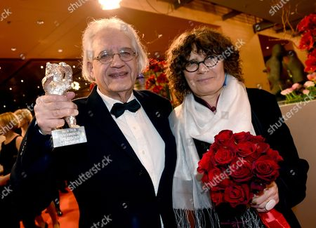 Chilean Writer-director Patricio Guzman (l) Holds Up the Silver Bear Award For Best Script Which He Won For 'The Pearl Button' (el Boton De Nacar) Next to German Producer Renate Sachse (r) at the Closing and Award Ceremony of the 65th Annual Berlin International Film Festival in Berlin Germany 14 February 2015 the Berlinale Runs From 05 to 15 February Germany Berlin