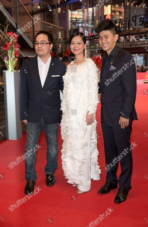 (l-r) Vietnamese Director Phan Dang Di and Vietnamese Actors Do Thi Hai Yen and Le Cong Hoang Arrive For the Premiere of 'Cha Va Con Va' (big Father Small Father and Other Stories) at the 65th Annual Berlin International Film Festival in Berlin Germany 13 February 2015 the Movie is Presented in the Official Competition of the Berlinale Which Runs From 05 to 15 February Germany Berlin
