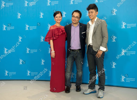 Stock Image of Vietnamese Actress Do Thi Hai Yen (l) Director Phan Dang Di (c) and Actor Le Cong Hoang (r) Pose During a Photocall For the Film 'Big Father Small Father and Other Stories' (cha Va Con Va) at the 65th Annual Berlin International Film Festival in Berlin Germany 13 February 2015 the Movie is Presented in the Official Competition of the Berlinale Which Runs From 05 to 15 February 2015 Germany Berlin