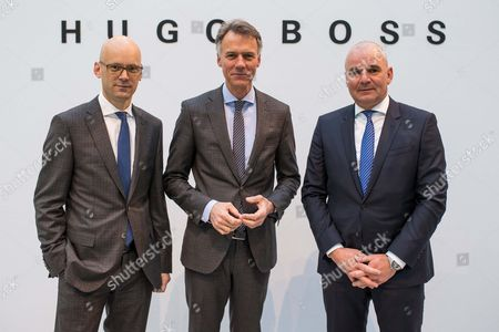 Chief Executive Officer of the Hugo Boss Ag Claus-dietrich Lahrs (c) Chief Financial Officer Mark Langer (l) and Member of the Board Responsible For the Brand Christoph Auhagen (r) Pose Prior to the Balance Press Conference on the Business Year 2014 in Metzingen Germany 12 March 2015 Reports Said the German Fashion House Had Dismissed Its 2015 Sales Target of Three Billion Euros Citing Less Than Expected Luxury Spending in Europe and China Germany Metzingen