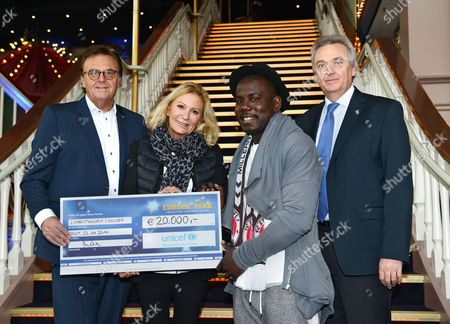 A Picture Made Available on 23 November 2014 Shows Europa Park Rust General Managers Roland Mack (l) and Juergen Mack (r) Handing Over a 20 000 Eur Check to United Nations Children's Fund Unicef Ambassadors Sabine Christiansen (2-l) and Kweku Mandela (2-r) at Europa Park in Rust Germany 22 November 2014 South African Film Producer Kweku Mandela Grandson of Later Former South African President Nelson Mandela was in Rust to Launch an Aid Project For South Africa Somalia and South Sudan the Goal of the Project is to Provide Residents of Poor Neighborhoods There with Clean Water and to Protect Them This Way From Diseases and Epidemics the 29-year-old Told German Press Agencydpa That He was Wearing the Scarf of Fc St Pauli Because the Soccer Club is Committed to Fight Racism Germany Rust