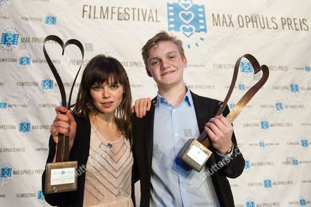 Stock Photo of Actors Benjamin Lutzke (r) and Lore Richter Pose with Their Throphies After the Award Ceremony of the 36th Max Ophuels Film Festival at the E-werk in Saarbruecken Germany 24 January 2015 Lutzke and Richter Won the Best Young Actor and Actress Awards Germany Saarbruecken