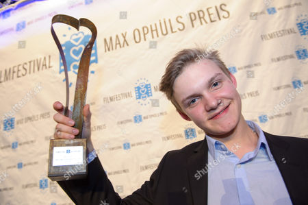 Actor Benjamin Lutzke Poses with His Best Young Actor Trophy After the Award Ceremony of the 36th Max Ophuels Film Festival at the E-werk in Saarbruecken Germany 24 January 2015 Germany Saarbruecken