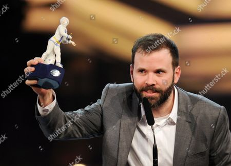Swiss Filmmaker Baran Bo Odar Receives the Best Director Award For His Movie 'Who Am i - Kein System Ist Sicher' During the Bavarian Film Awards Ceremony at the Prinzregententheater in Munich Germany 16 January 2015 Germany Munich