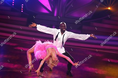 Stock Image of A Picture Made Available on 06 June 2015 Shows Ghanaian-german Former Soccer Player Hans Sarpei (r) and Professional Dancer Kathrin Menzinger Performing During the Final of the Eighth Edition of 'Let's Dance' in Cologne Germany 05 June 2015 the Rtl Television Program is the German Version of the Us Show 'Dancing with the Stars' Germany Cologne