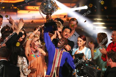 A Picture Made Available on 06 June 2015 Shows Ghanaian-german Former Soccer Player Hans Sarpei (c-r) and Professional Dancer Kathrin Menzinger (c-l) Reacting After Winning the Final of the Eighth Edition of 'Let's Dance' in Cologne Germany 05 June 2015 the Rtl Television Program is the German Version of the Us Show 'Dancing with the Stars' Germany Cologne