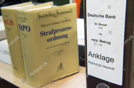 Two Books That Read 'Strafgesetzbuch' (criminal Code) and 'Strafprozessordnung'á(code of Criminal Procedure) Have Been Placed Next to a Ring Binder That Reads 'Deutsche Bank - Dr Breuer U a Wg Vers Betrug U a - Anklage - Beglaubigte Abschrift' (lit Deutsche Bank - Dr Breuer Et Al Attempted Fraud Etc - Charges - Authenticated Transcript) in a Courtroom of the District Court in Munich Germany 28 April 2015 Five Managers Including the Current Co-head of Deutsche Bank Are Accused of Attempted Fraud During a Trial Related to the Bankruptcy of Deceased Media Entrepreneur Leo Kirch Germany Munich