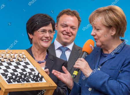 Premier of Thuringia Christine Lieberknecht (l) Gives a Chess Board to German Chancellor Angela Merkel (r) During an Election Campaign Event of the German Christian Democratic Union Party (cdu) in Apolda Germany 13 September 2014 at (c) is Cdu Thuringia Secretary General Mario Vogt Thuringia Will Hold Parliamentary Elections on 14 September Germany Apolda