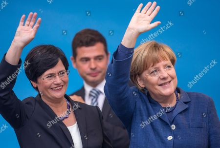 Premier of Thuringia Christine Lieberknecht (l) and German Chancellor Angela Merkel (r) Wave During an Election Campaign Event of the German Christian Democratic Union Party (cdu) in Apolda Germany 13 September 2014 at (c) is Cdu Thuringia Faction Leader Mike Mohring Thuringia Will Hold Parliamentary Elections on 14 September Germany Apolda