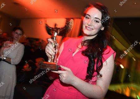 A Picture Made Available on 26 March 2015 Shows German Actress Maria Ehrich Holding Her Award in the Category 'Best Actress National' at the Party After the Jupiter Award Ceremony in Berlin Germany 25 March 2015 German Magazines Cinema and Tv Spielfilm Presented the Audience Award to National and International Stars For the 36th Time Germany Berlin