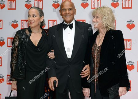 Us Singer Harry Belafonte (c) Hsi Wife Pamela (r) and Daughter Gina (l) Arrive For the Charity Gala 'Ein Herz Fuer Kinder' (lit a Heart For Children) in Berlin Germany 06 December 2014 the German Television Channel Zdf and the Newspaper 'Bild' Collected Donations For Children's Charity Organisations in Germany and Worldwide Germany Berlin