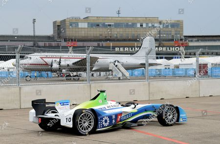 Italian Driver Jarno Trulli of Team Trulli Drives Along the Race Track of the Fia Formula E Race at the Former Tempelhof Airport in Berlin Germany 23 May 2015 a So-called Raisin Bomber is Pictured in the Background the Fia Formula E Race in Berlin Takes Place on 23 May 2015 Germany Berlin