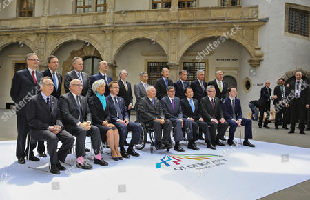 Stock Image of A Group Photo at the G7 Meeting of Finance Ministers in the Royal Palace in Dresden ágermany 28 May 2015 Italian Minister Pier Carlo Padoan (1st Row L-r) French Finance Minister Michel Sapin Director of the International Monetary Fund (imf) Christine Lagarde President of the Deutsche Bundesbank Jens Weidmann German Minister of Finance Wolfgang Schaeuble Us Secretary of the Treasury Jacob J Lew Japanese Finance Minister Taro Aso Canadian Finance Minister Joe Oliver Finance Minister of Great Britain George Osborne President of the Banca D'italia Ignazio Visco (2nd Row L-r) President of Theáeuropean Central Bank (ecb) Mario Draghi President of the Bank of Canada Stephen S Poloz Economic and Financial Affairs Commissioner of the Eu Commission Pierre Moscovici Us American Economist Steven B Kamin President of the Bank of Japan Haruhiko Kuroda President of the World Bank Group Jim Yong Kim President Bank of England Mark Carney President of the Banque De France Christian Noyer and the General Secretary of the the Organisation For Economic Co-operation and Development (oecd) Jose Angel Gurria Can Be Seen Finance Ministers and Central Bank Governors From the Seven Leading Western Industrial States (g7) Are Meeting in the Capital of Saxony From 27 to 29 May 2015 Germany Dresden