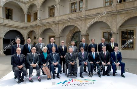Stock Picture of A Group Photo at the G7 Meeting of Finance Ministers in the Royal Palace in Dresden ágermany 28 May 2015 Italian Minister Pier Carlo Padoan (1st Row L-r) French Finance Minister Michel Sapin Director of the International Monetary Fund (imf) Christine Lagarde President of the Deutsche Bundesbank Jens Weidmann German Minister of Finance Wolfgang Schaeuble Us Secretary of the Treasury Jacob J Lew Japanese Finance Minister Taro Aso Canadian Finance Minister Joe Oliver Finance Minister of Great Britain George Osborne President of the Banca D'italia Ignazio Visco (2nd Row L-r) President of Theáeuropean Central Bank (ecb) Mario Draghi President of the Bank of Canada Stephen S Poloz Economic and Financial Affairs Commissioner of the Eu Commission Pierre Moscovici Us American Economist Steven B Kamin President of the Bank of Japan Haruhiko Kuroda President of the World Bank Group Jim Yong Kim President Bank of England Mark Carney President of the Banque De France Christian Noyer and the General Secretary of the the Organisation For Economic Co-operation and Development (oecd) Jose Angel Gurria Can Be Seen Finance Ministers and Central Bank Governors From the Seven Leading Western Industrial States (g7) Are Meeting in the Capital of Saxony From 27 to 29 May 2015 Germany Dresden