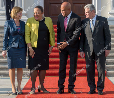 German President Joachimágauck (r) and His Partner Daniela Schadt (l) Pose with President of Haiti Michel Joseph Martelly (2-r) and His Wife Sophia (2-l) For the Media Outside of the German President's Residence the Bellevue Palace in Berlin Germany 29áoctober 2014 Germany Berlin