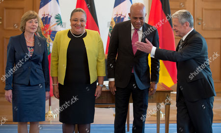 German President Joachimágauck (r) and His Partner Daniela Schadt (l) Pose For the Media with the President of Haiti Michel Joseph Martelly (2-r) and His Wife Sophia (2-l) at the German President's Residence the Bellevue Palace in Berlin Germany 29áoctober 2014 Germany Berlin