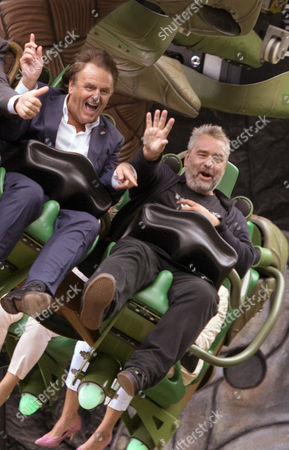 Manager of Europa Park Amusement Park Roland Mack (l) and French Director Luc Besson (r) Sit in the New Ride 'Arthur and the Minimoys' During Its Opening at Europa-park in Rust Germany 18 September 2014 Germany Rust