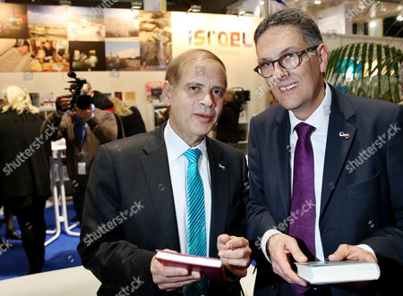 Stock Image of Israeli Ambassador Yakov Hadas-handelsman (l) and the Director of the Leipzig Book Fair Oliver Zille Talk at the Stand of Israel at the Leipzig Book Fair in Leipzig Germany 12 March 2015 About 50 Years After the Start of the Diplomatic Relationships Between the Two Countries the Leipzig Book Fair Puts a Focus on the Topic More Than a Dozen of Israeli Writers Are Invited About 2 000 Publishing Houses From 42 Countries Present Their New Releases From 12 to 15march Germany Leipzig