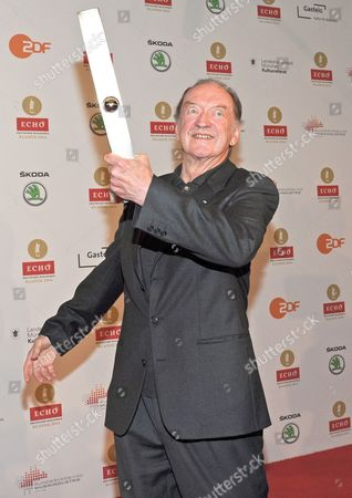Stock Photo of Austrian Conductor Nikolaus Harnoncourt Poses with His Lifetime Achievement Award at the 'Echo Klassik' Classical Music Award Ceremony in Munich ágermany 26 October 2014 Germany Munich