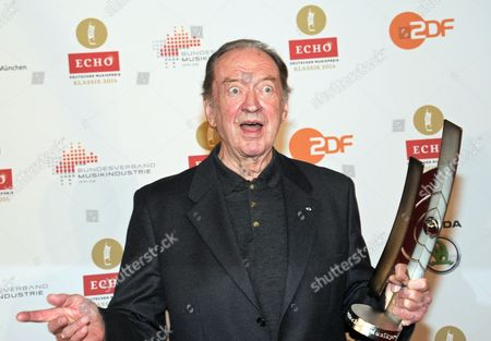 Stock Image of Austrian Conductor Nikolaus Harnoncourt Poses with His Lifetime Achievement Award at the 'Echo Klassik' Classical Music Award Ceremony in Munich ágermany 26 October 2014 Germany Munich